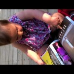 One-Year-Old Tries to Work Magazine Like an iPad