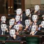 Left and Right join together to protest ACTA in Poland, some wearing Guy Fawkes masks