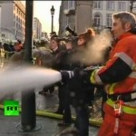 Mindless Cops Serve Masters While Hosed By Gang of Firemen