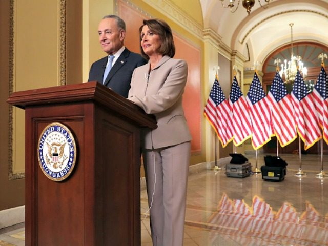 Speaker of the House Nancy Pelosi (D-CA) (R) and Senate Minority Leader Charles Schumer (D-NY) pose for photographs after delivering a televised response to President Donald Trump's national address about border security at the U.S. Capitol January 08, 2019 in Washington, DC. Republicans and Democrats seem no closer to an …